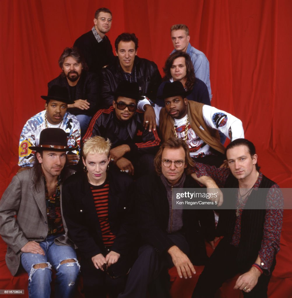 Adam Clayton, Larry Mullen Jr, Bob Seger, Bruce Springsteen, John Mellencamp, Run DMC, The Edge, Annie Lennox, Sting and Bono) are photographed for a Very Special Christmas in 1987.