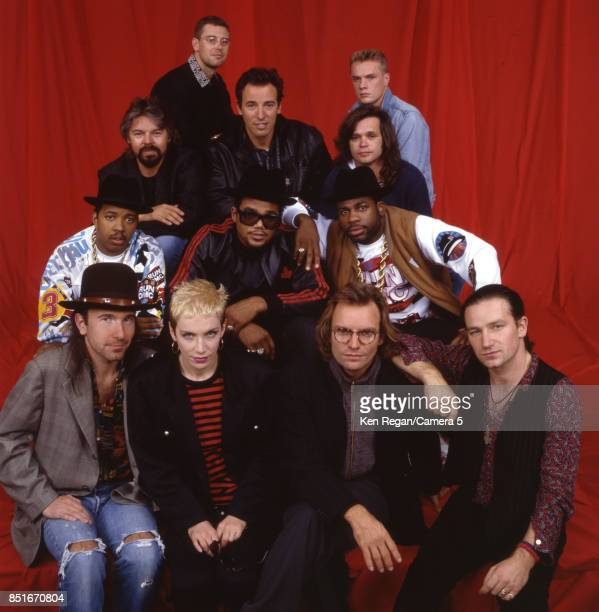 Adam Clayton Larry Mullen Jr Bob Seger Bruce Springsteen John Mellencamp Run DMC The Edge Annie Lennox Sting and Bono are photographed for a Very...