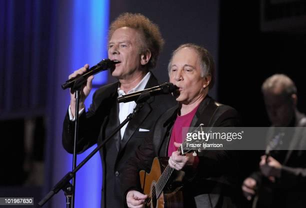 Musicians Art Garfunkel and Paul Simon of Simon Garfunkel perform during the 38th AFI Life Achievement Award honoring Mike Nichols held at Sony...