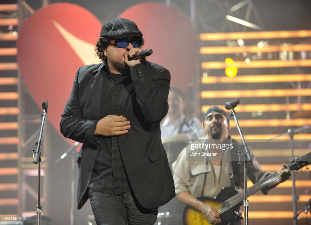 Musicians Asdru and Raul of the band Ozomatli perform at the 2010 MusiCares Person Of The Year Tribute To Neil Young at the Los Angeles Convention...
