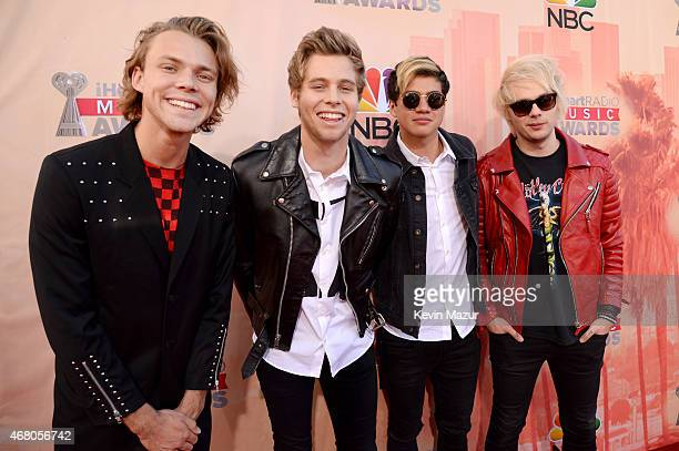 Musicians Ashton Irwin Luke Hemmings Calum Hood and Michael Clifford of 5 Seconds of Summer attend the 2015 iHeartRadio Music Awards which...