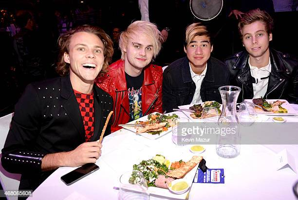 Musicians Ashton Irwin Michael Clifford Calum Hood and Luke Hemmings of 5 Seconds of Summer attend the 2015 iHeartRadio Music Awards which...
