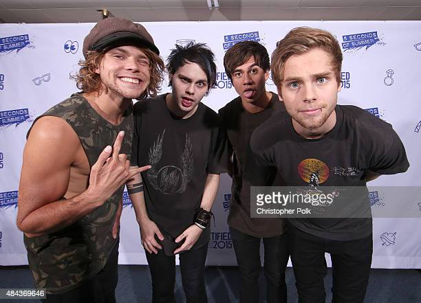 Musicians Ashton Irwin Michael Clifford Calum Hood and Luke Hemmings of 5 Seconds of Summer pose backstage during Vevo Certified Live at Barker...