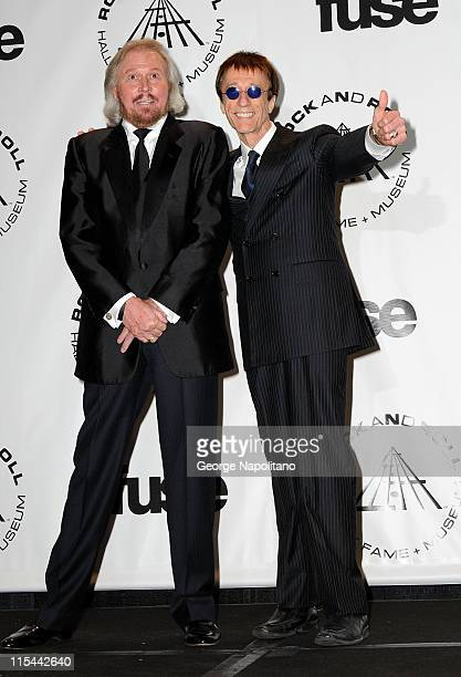 Musicians Barry Gibb and Robin Gibb of the Bee Gees attend the 25th Annual Rock And Roll Hall Of Fame Induction Ceremony at the Waldorf=Astoria on...