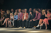 Musicians Beck Justin Bieber Joan Jett and Mark Ronson watch a model walk the runway during the Saint Laurent show at The Hollywood Palladium on...