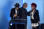Musicians Ben Harper Charlie Musselwhite and Cyndi Lauper onstage during the 56th GRAMMY Awards PreTelecast at Nokia Theatre LA Live on January 26...
