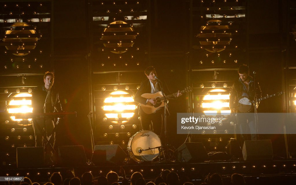 Musicians Ben Lovett Marcus Mumford and Winston Marshall of Mumford Sons perform onstage at the 55th Annual GRAMMY Awards at Staples Center on...