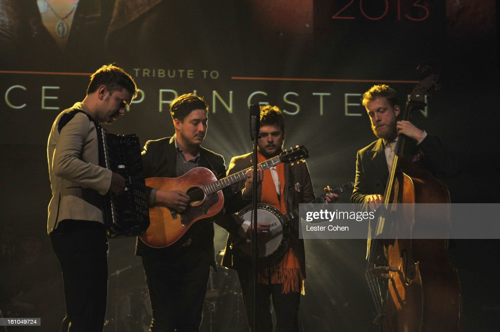 Musicians Ben Lovett Marcus Mumford 'Country' Winston Marshall and Ted Dwane of Mumford Sons perform onstage at MusiCares Person Of The Year Honoring...