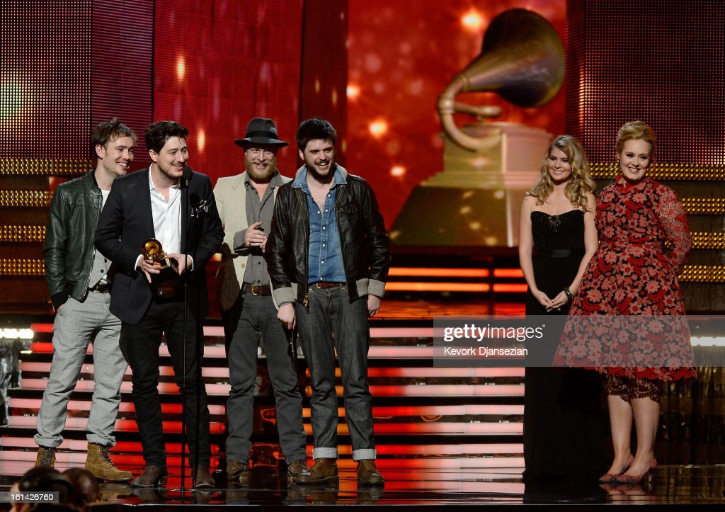 Musicians Ben Lovett Marcus Mumford Ted Dwane and Winston Marshall of Mumford Sons accept Album of the Year award for 'Babel' with presenter Adele...