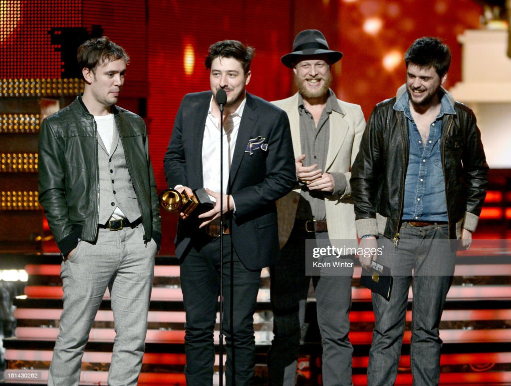 Musicians Ben Lovett Marcus Mumford Ted Dwane and Winston Marshall of Mumford Sons accept Album of the Year award for 'Babel' onstage during the 55th...