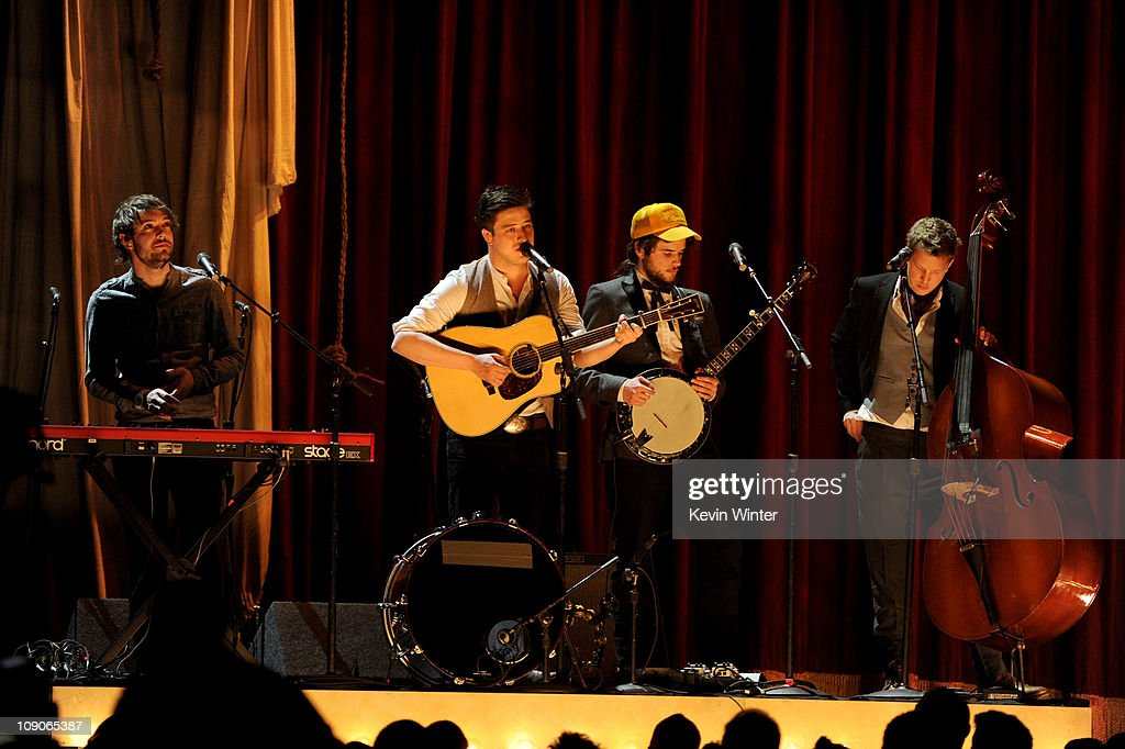 Musicians Ben Lovett, <a gi-track='captionPersonalityLinkClicked' href=/galleries/search?phrase=Marcus+Mumford&family=editorial&specificpeople=5385533 ng-click='$event.stopPropagation()'>Marcus Mumford</a>, Winston Marshall, and Ted Dwane of Mumford and Sons perform onstage during The 53rd Annual GRAMMY Awards held at Staples Center on February 13, 2011 in Los Angeles, California.