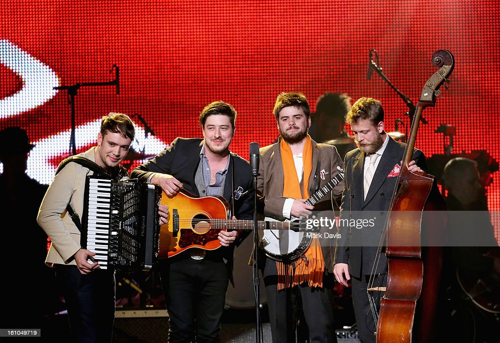 Musicians Ben Lovett Marcus Mumford Winston Marshall and Ted Dwane of Mumford Sons perform onstage at MusiCares Person Of The Year Honoring Bruce...