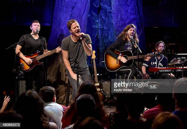 Musicians Ben McKee Dan Reynolds Daniel Wayne Sermon and Daniel Platzman of Imagine Dragons perform onstage during iHeartRadio presents 'Imagine...