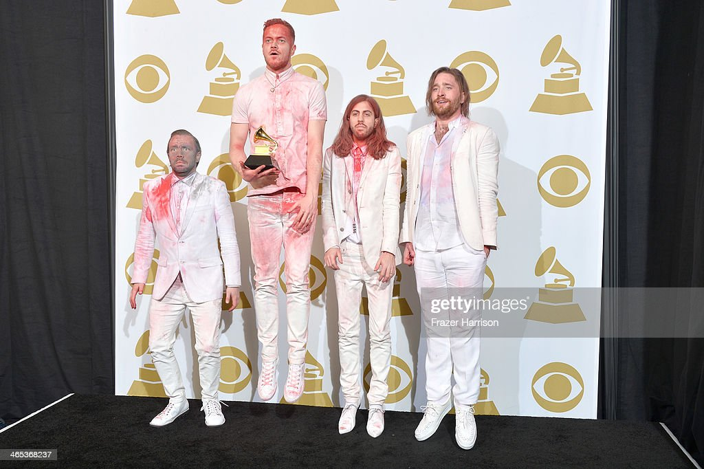 Musicians <a gi-track='captionPersonalityLinkClicked' href=/galleries/search?phrase=Ben+McKee&family=editorial&specificpeople=8995201 ng-click='$event.stopPropagation()'>Ben McKee</a>, <a gi-track='captionPersonalityLinkClicked' href=/galleries/search?phrase=Dan+Reynolds&family=editorial&specificpeople=8995077 ng-click='$event.stopPropagation()'>Dan Reynolds</a>, Wayne Sermon, and Daniel Platzman of Imagine Dragons, winners of the Best Rock Performance Award for 'Radioactive' pose in the press room during the 56th GRAMMY Awards at Staples Center on January 26, 2014 in Los Angeles, California.