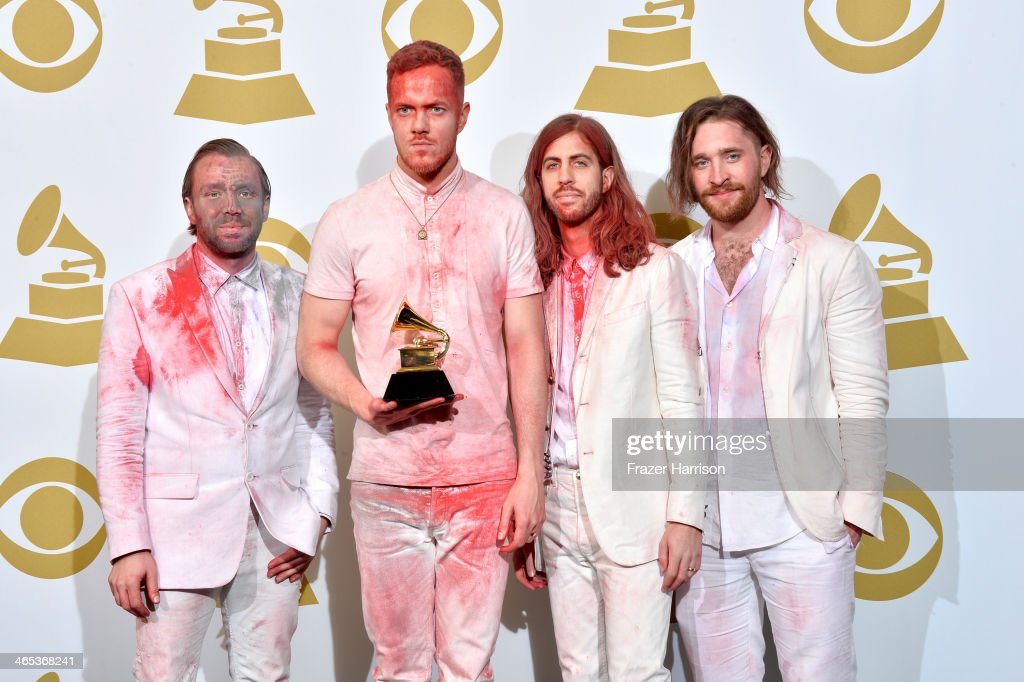 Musicians Ben McKee, Dan Reynolds, Wayne Sermon, and Daniel Platzman of Imagine Dragons, winners of the Best Rock Performance Award for 'Radioactive' pose in the press room during the 56th GRAMMY Awards at Staples Center on January 26, 2014 in Los Angeles, California.