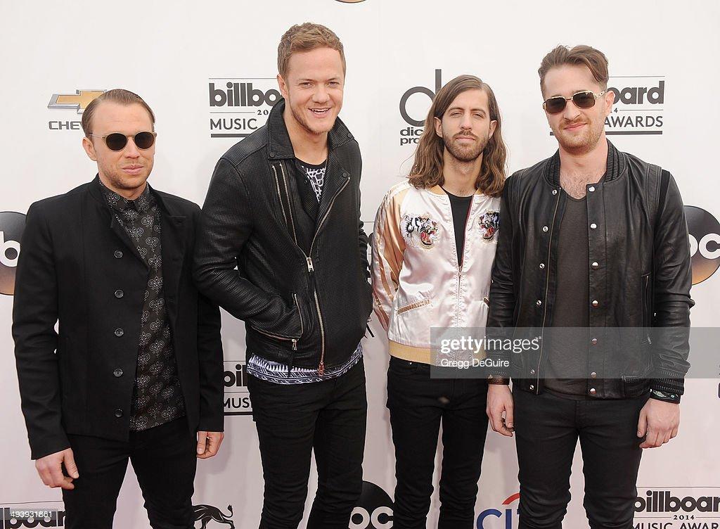 Musicians Ben McKee, Dan Reynolds, Wayne Sermon and Daniel Platzman of Imagine Dragons arrive at the 2014 Billboard Music Awards at the MGM Grand Garden Arena on May 18, 2014 in Las Vegas, Nevada.