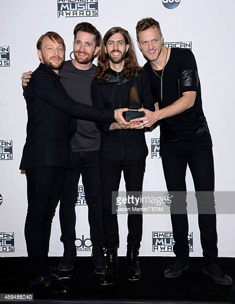 Musicians Ben McKee Daniel Platzman Wayne Sermon and Dan Reynolds of Imagine Dragons winners of Favorite Alternative Artist pose in the press room at...