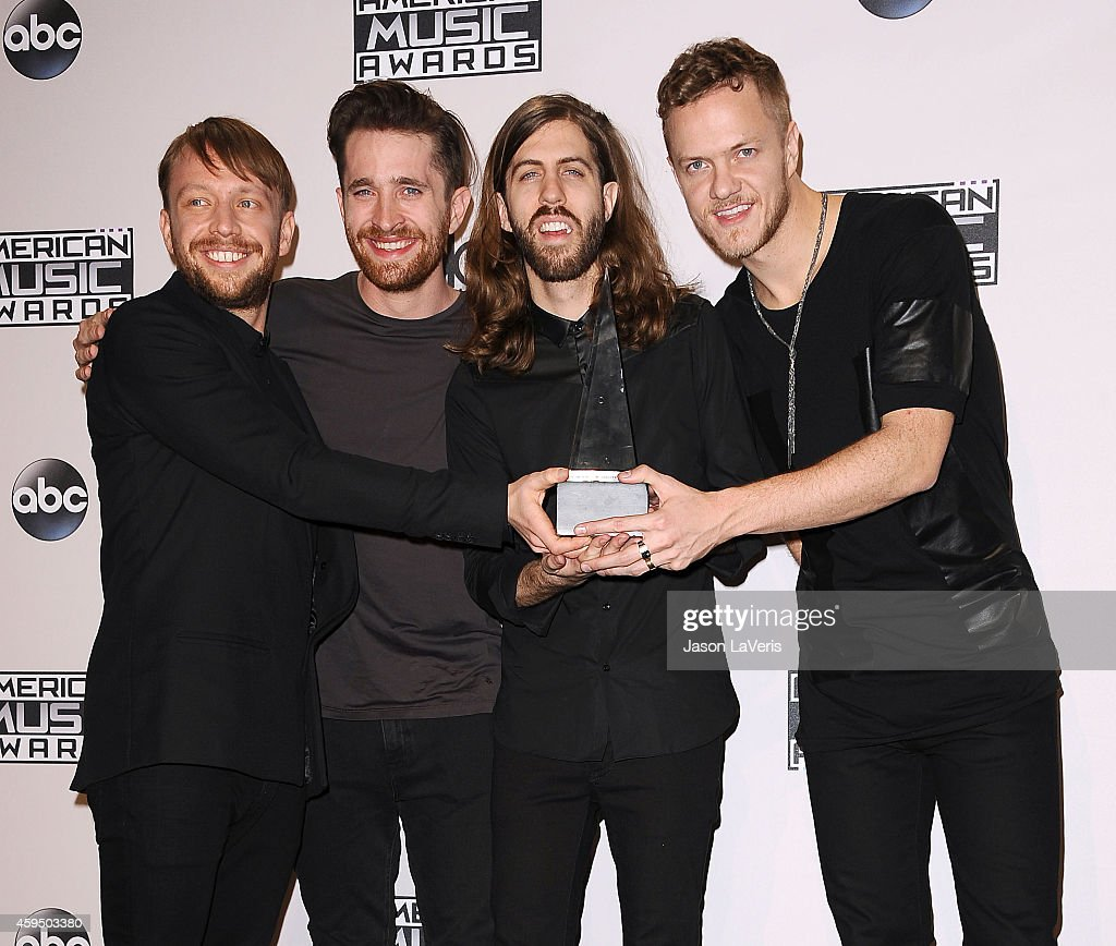 Musicians Ben McKee, Daniel Platzman, Wayne Sermon, and Dan Reynolds of Imagine Dragons pose in the press room at the 2014 American Music Awards at Nokia Theatre L.A. Live on November 23, 2014 in Los Angeles, California.
