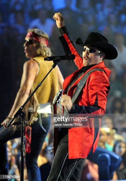 Musicians Big Kenny and John Rich of Big Rich perform on stage at the 2011 CMT Music Awards at the Bridgestone Arena on June 8 2011 in Nashville...