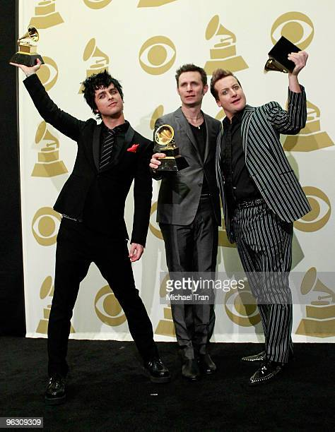 Musicians Billie Joe Armstrong Mike Dirnt and Tre Cool of Green Day pose in the press room at the 52nd Annual GRAMMY Awards held at Staples Center on...
