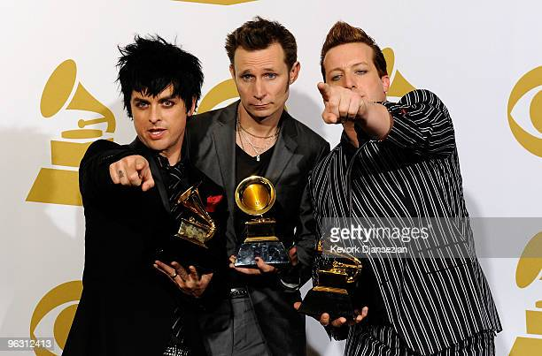 Musicians Billie Joe Armstrong Mike Dirnt and Tre Cool of Green Day pose with Best Rock Album for '21st Century Breakdown' in the press room during...