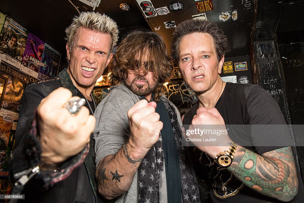 Musicians <a gi-track='captionPersonalityLinkClicked' href=/galleries/search?phrase=Billy+Idol&family=editorial&specificpeople=138578 ng-click='$event.stopPropagation()'>Billy Idol</a>, <a gi-track='captionPersonalityLinkClicked' href=/galleries/search?phrase=Billy+Ray+Cyrus&family=editorial&specificpeople=213601 ng-click='$event.stopPropagation()'>Billy Ray Cyrus</a> and Billy Morrison pose backstage during the Camp Freddy holiday residency at The Roxy Theatre on December 20, 2013 in West Hollywood, California.