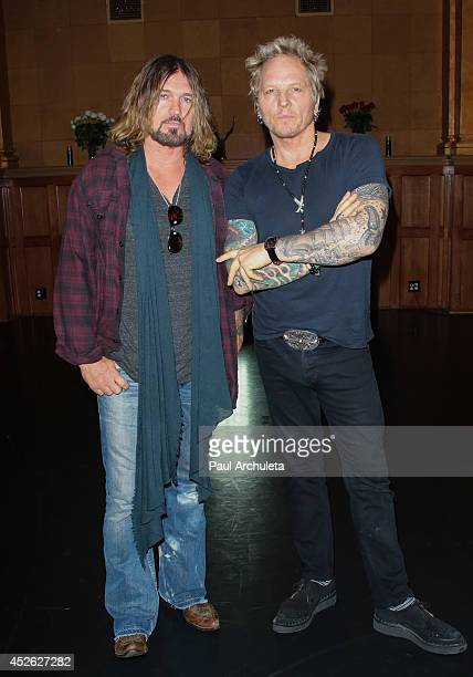 Musicians Billy Ray Cyrus and Matt Sorum pose for pictures at the filming of 'Do What I Do' video shoot on July 24 2014 in Los Angeles California