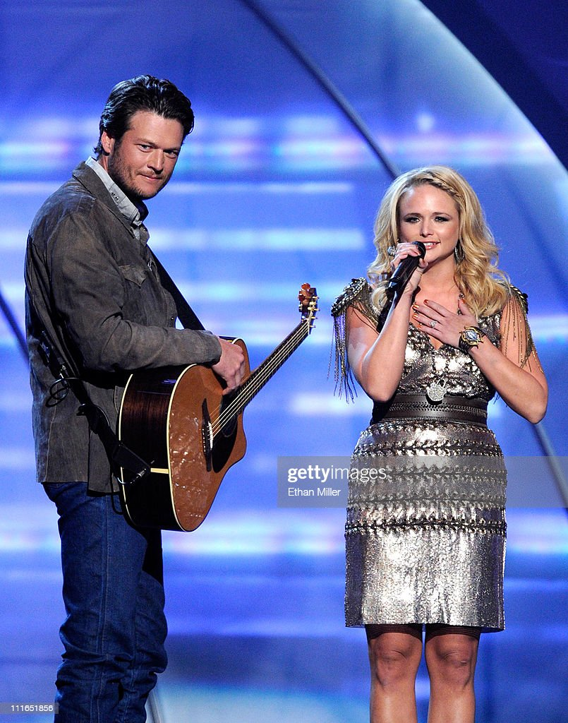 Musicians <a gi-track='captionPersonalityLinkClicked' href=/galleries/search?phrase=Blake+Shelton&family=editorial&specificpeople=2352026 ng-click='$event.stopPropagation()'>Blake Shelton</a> and <a gi-track='captionPersonalityLinkClicked' href=/galleries/search?phrase=Miranda+Lambert&family=editorial&specificpeople=571972 ng-click='$event.stopPropagation()'>Miranda Lambert</a> speak onstage during ACM Presents: Girls' Night Out: Superstar Women of Country concert held at the MGM Grand Garden Arena on April 4, 2011 in Las Vegas, Nevada.