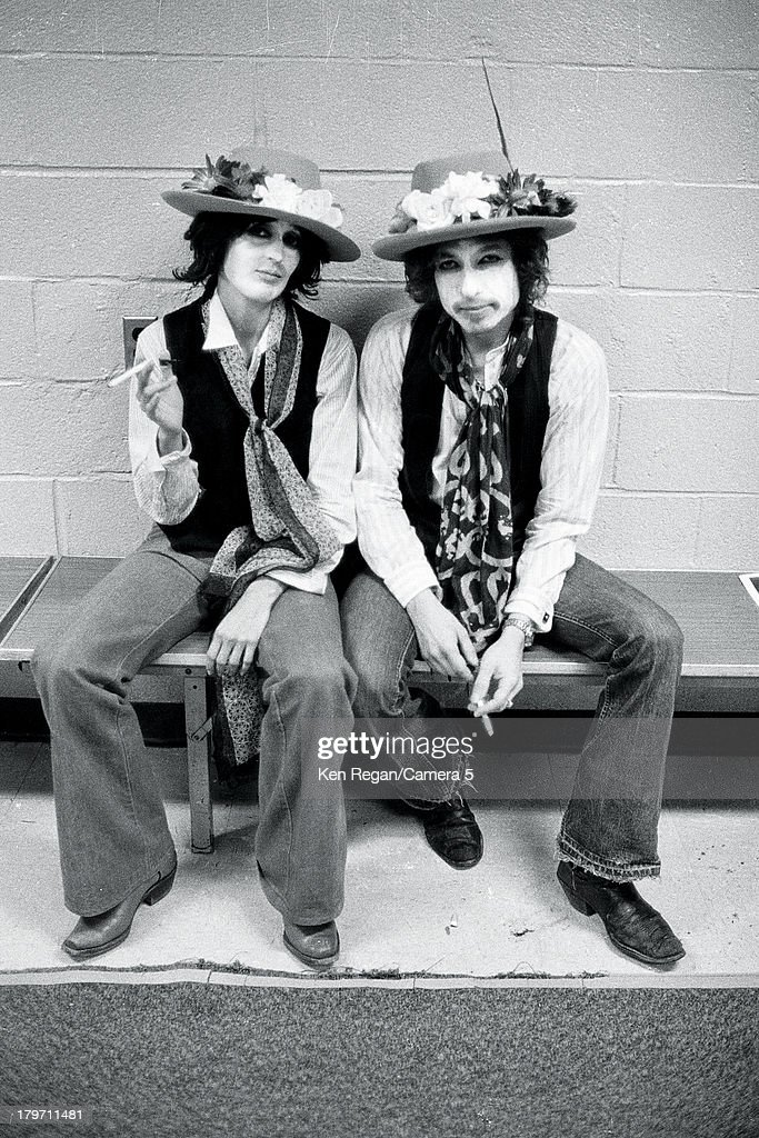 Musicians Bob Dylan and Joan Baez are photographed backstage at Madison Square Garden during the Rolling Thunder Revue on December 8, 1975 in New York City.