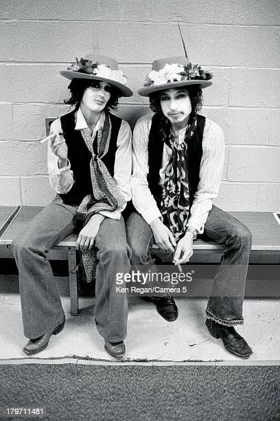 Musicians Bob Dylan and Joan Baez are photographed backstage at Madison Square Garden during the Rolling Thunder Revue on December 8 1975 in New York...