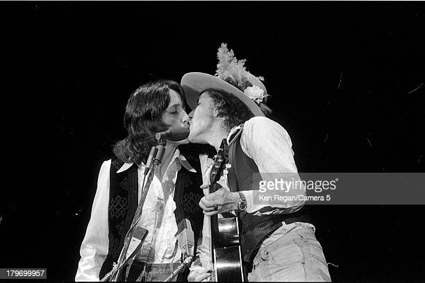 Musicians Bob Dylan and Joan Baez are photographed onstage during the Rolling Thunder Revue in November 1975 in Springfield Massachusetts CREDIT MUST...