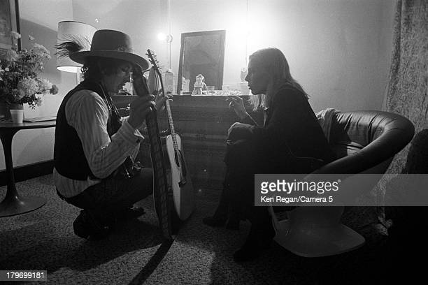 Musicians Bob Dylan and Joni Mitchell are photographed backstage during the Rolling Thunder Revue in December 1975 in Cambridge Massachusetts CREDIT...
