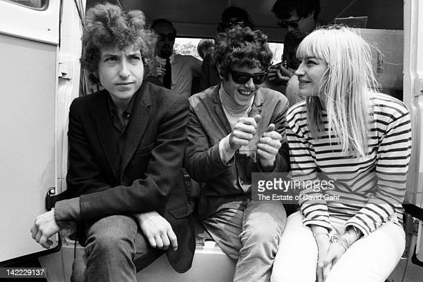 Musicians Bob Dylan Donovan and Mary Travers of Peter Paul and Mary backstage at the Newport Folk Festival in July 1965 in Newport Rhode Island