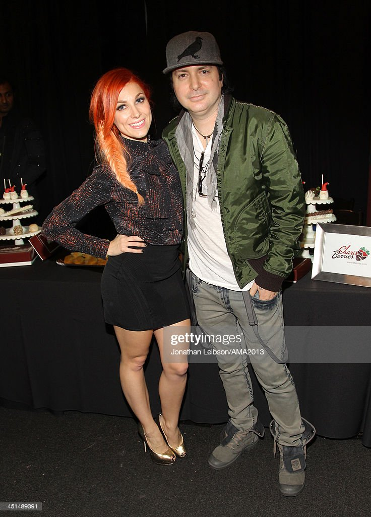 Musicians Bonnie McGee and Kevin Rudolf attend day 1 of the 2013 American Music Awards gift suite at Nokia Theatre LA Live on November 22 2013 in Los...