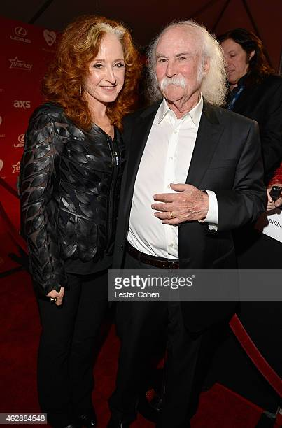 Musicians Bonnie Raitt and David Crosby attend the 25th anniversary MusiCares 2015 Person Of The Year Gala honoring Bob Dylan at the Los Angeles...