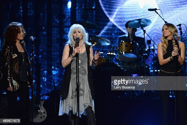Musicians Bonnie Raitt Emmylou Harris and Carrie Underwood perform onstage at the 29th Annual Rock And Roll Hall Of Fame Induction Ceremony at...