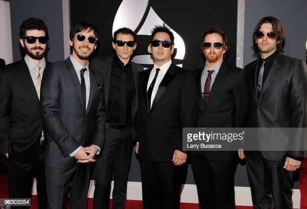 Musicians Brad Delson Mike Shinoda Chester Bennington Joe Hahn David 'Phoenix' Farrell and Rob Bourdon of the band Linkin Park arrive at the 52nd...
