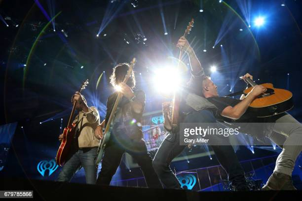 Musicians Brad Tursi Geoff Sprung Matthew Ramsey and Trevor Rosen of Old Dominion performs onstage during the 2017 iHeartCountry Festival A Music...