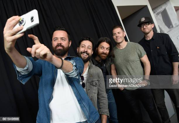Musicians Brad Tursi Matthew Ramsey Geoff Sprung Trevor Rosen and Whit Sellers of Old Dominion pose for a selfie during the 52nd Academy Of Country...