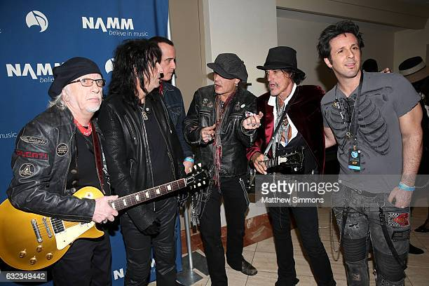 Musicians Brad Whitford Alice Cooper Robert DeLeo Johnny Depp Joe Perry and Glen Sobel pose for a photograph backstage at the TEC Awards during NAMM...