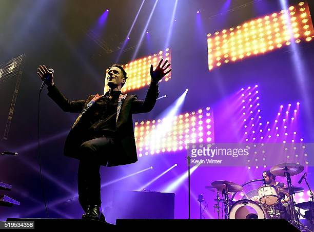 Musicians Brandon Flowers and Ronnie Vannucci Jr of The Killers perform onstage during the grand opening of TMobile Arena on April 6 2016 in Las...