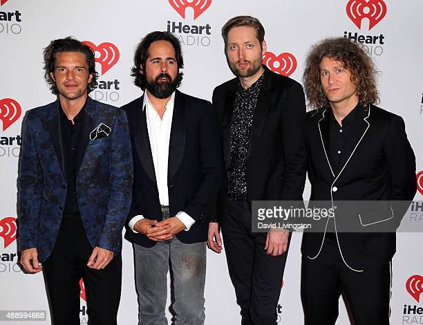 Musicians Brandon Flowers Ronnie Vannucci Jr Mark Stoermer and Dave Keuning of The Killers pose in the press room at the 2015 iHeartRadio Music...