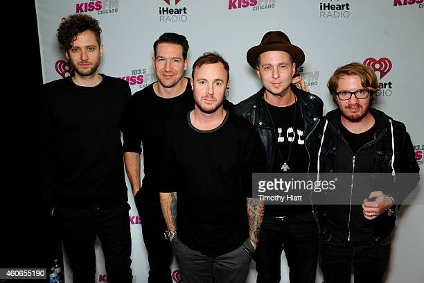 Musicians Brent Kutzle Zach Filkins Eddie Fisher Ryan Tedder and Drew Brown of OneRepublic attend 1035 KISS FM's Jingle Ball 2014 at Allstate Arena...