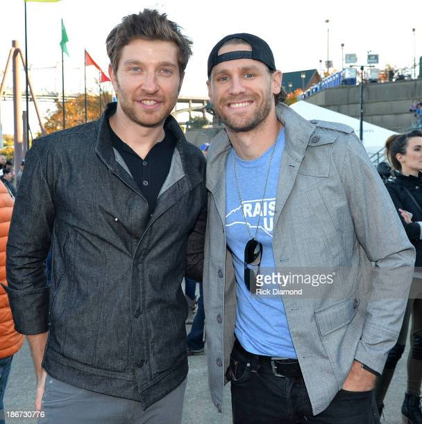 Musicians Brett Eldredge and Chase Rice attend Dierks Bentley's 8th annual Miles Music for Kids at Riverfront Park on November 3 2013 in Nashville...