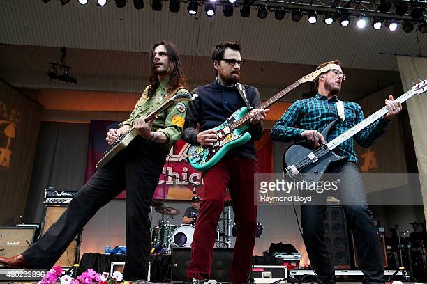 Musicians Brian Bell Rivers Cuomo and Scott Shriner from Weezer performs at the Petrillo Music Shell during the 35th Annual 'Taste Of Chicago' on...