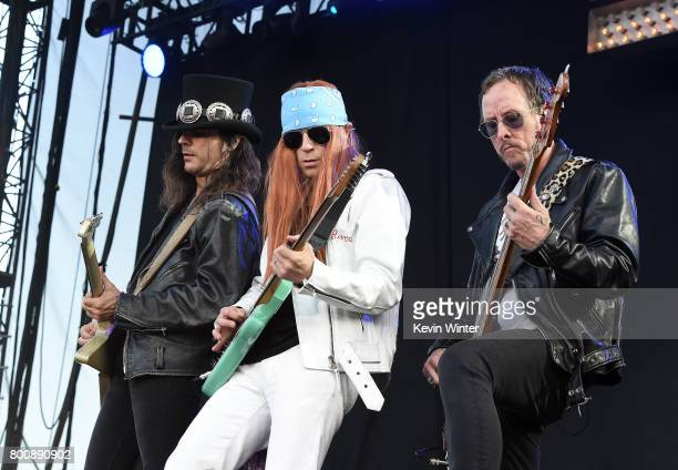 Musicians Brian Bell Rivers Cuomo and Scott Shriner of musical group Weezer perform on The Oak stage during Arroyo Seco Weekend at the Brookside Golf...