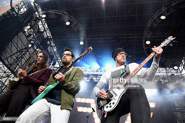Musicians Brian Bell Rivers Cuomo and Scott Shriner of the band Weezer perform onstage during the ATT Block Party at the NCAA March Madness Music...