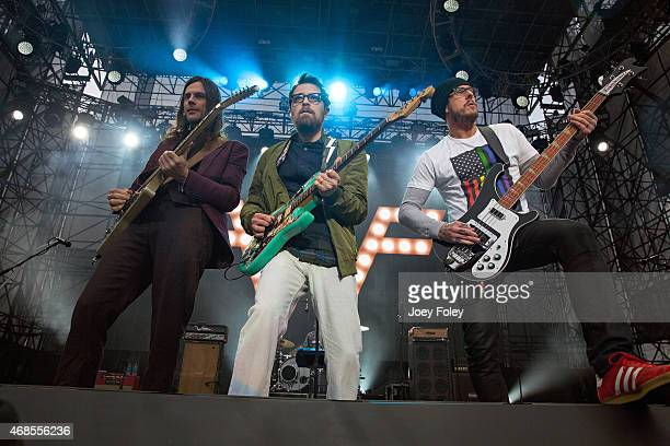 Musicians Brian Bell Rivers Cuomo and Scott Shriner of the band Weezer perform live onstage at White River State Park on April 3 2015 in Indianapolis...