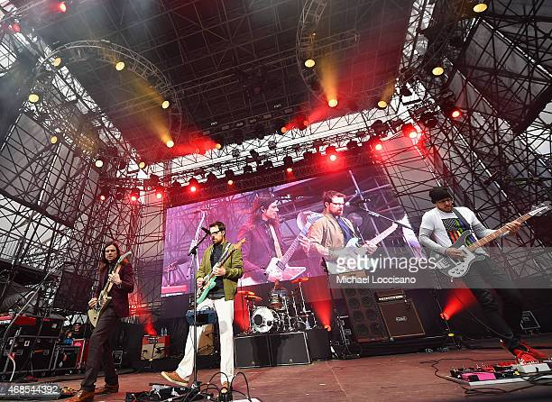 Musicians Brian Bell Rivers Cuomo Patrick Wilson and Scott Shriner of the band Weezer perform onstage during the ATT Block Party at the NCAA March...