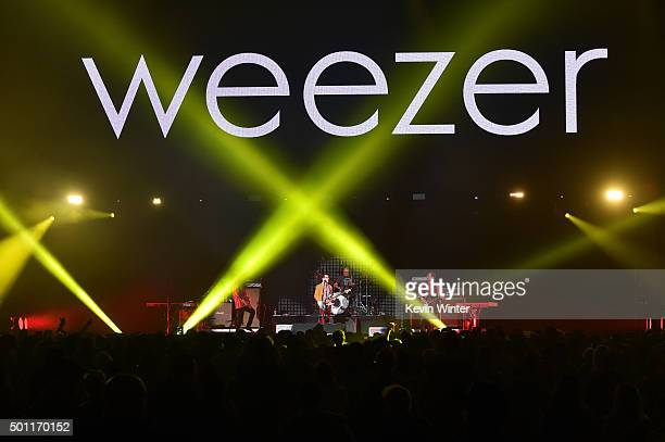 Musicians Brian Bell Rivers Cuomo Patrick Wilson and Scott Shriner of Weezer perform onstage during 1067 KROQ Almost Acoustic Christmas 2015 at The...